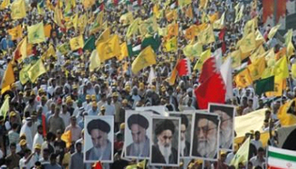 Demonstrators waving Hezbollah flags and holding pictures of Khomeini
